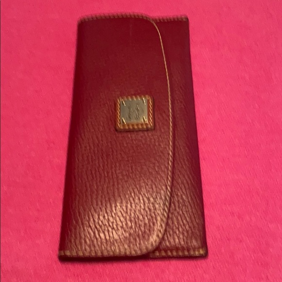 Brown, leather wallet by Dooley & Bourke.